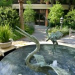 "Florida ""Egrets"" dance over a restorative pool of falling water. Sculpture can provide a garden narrative, add interest, and reconnect observers to a regional setting."